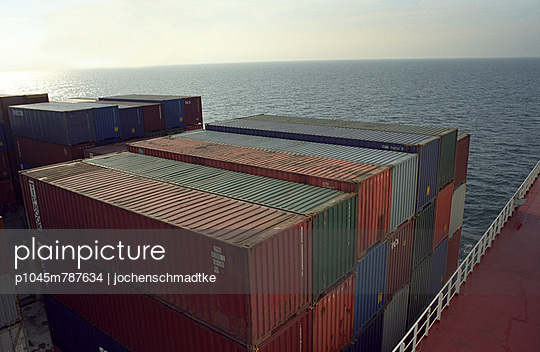 Sunset on a container ship - p1045m787634 by jochenschmadtke