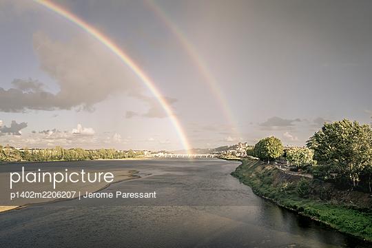 Double rainbow over Loire river, Saumur, France - p1402m2206207 by Jerome Paressant