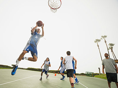Basketball team doing drills at practice - p555m1415514 by Erik Isakson