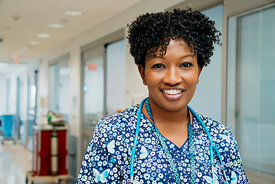 Portrait of confident female doctor in hospital lobby - p1166m1512628 by Cavan Images