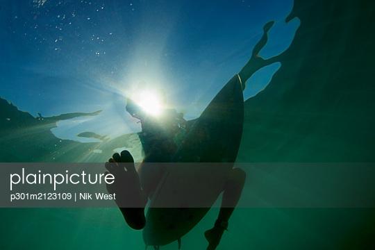 Surfboard under ocean surface - p301m2123109 by Nik West