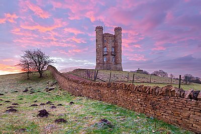 Broadway Tower and Cotswold drystone wall at sunrise, Broadway, Cotswolds, Worcestershire, England, United Kingdom, Europe - p871m1506665 by Stuart Black
