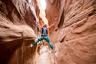 Woman exploring slot canyon, Grand Staircase-Escalante National Monument, Utah, USA - p343m1578151 by Suzanne Stroeer
