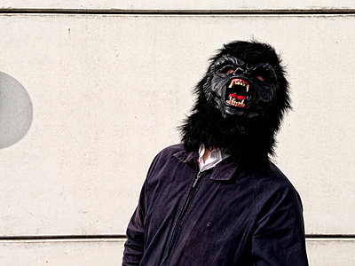 Germany, Berlin, man with gorilla mask - p300m1009332f by TeKa photography