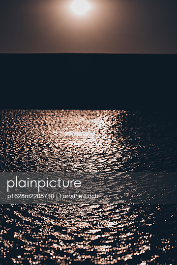 Sunset, sun rays on water - p1628m2208710 by Lorraine Fitch