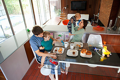 Family eating breakfast - p9242673f by Image Source