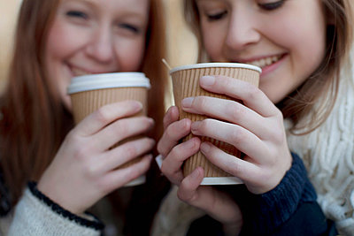Women having coffee together - p924m807247f by Sydney Bourne