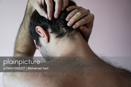 Miserable man head in hands  - p794m1092327 by Mohamad Itani