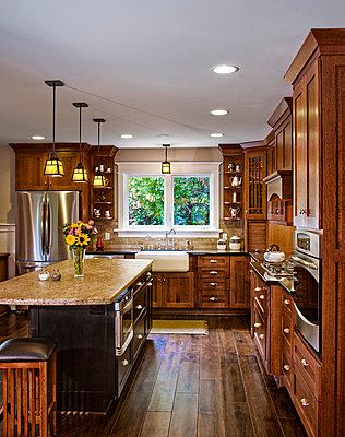 Hardwood floors and cabinets in kitchen - p5551665f by Alan Kim Boling