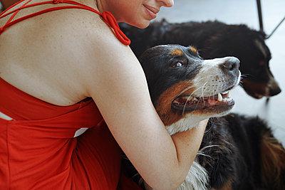 Woman petting her dogs - p1427m2067220 by Arman Zhenikeyev