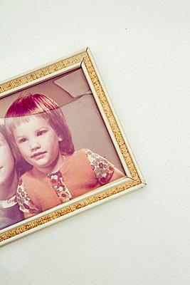 Old children's photo in a broken frame - p1621m2254246 by Anke Doerschlen