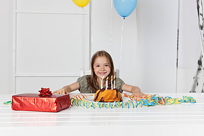 Girl with birthday cake and gift - p30020359f by Carlos Hernandez