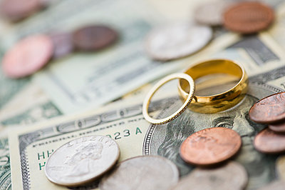 Close up of wedding rings with money - p555m1411454 by JGI/Jamie Grill