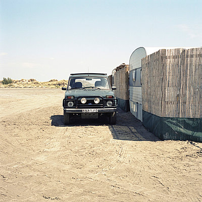 Car parked by a camping site - p9111490 by Gaëtan Rossier