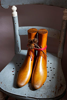 Vintage wooden shoehorns on weathered chair in Isle of Wight home;  UK - p349m920027 by Rachel Whiting