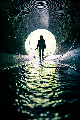 Detective in Tunnel with Water - p1019m1477051 by Stephen Carroll