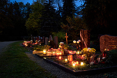 All saints with lit candles on graves - p1312m2193648 by Axel Killian