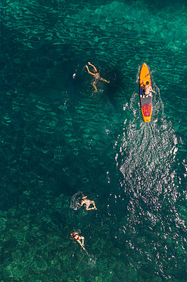 Swimming and Stand Up Paddling - p1437m2283282 by Achim Bunz