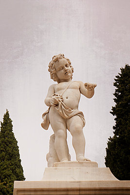Statue of cherub in graveyard - p597m1574269 by Tim Robinson