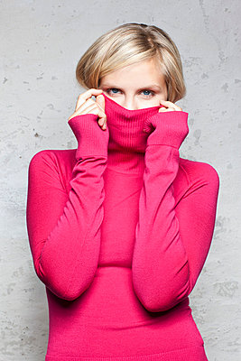 Young woman in a pink turtleneck - p6420154 by brophoto