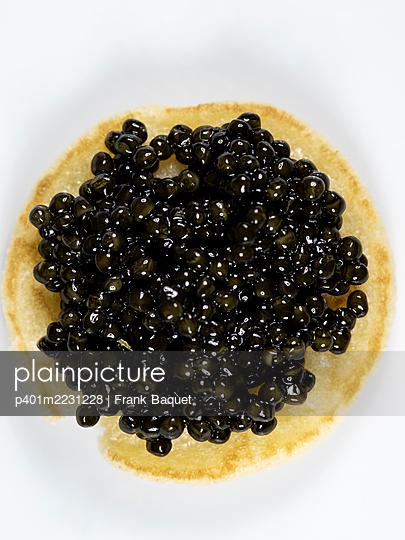 Sturgeon caviar on blini - p401m2231228 by Frank Baquet