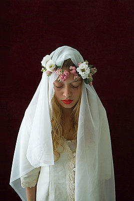 A bride seated with a crown of flowers - p6780010 by Christine Mathieu