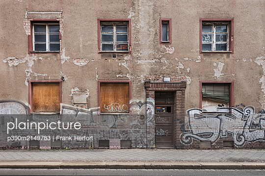 Unrestored dilapidated old building facade - p390m2149783 by Frank Herfort