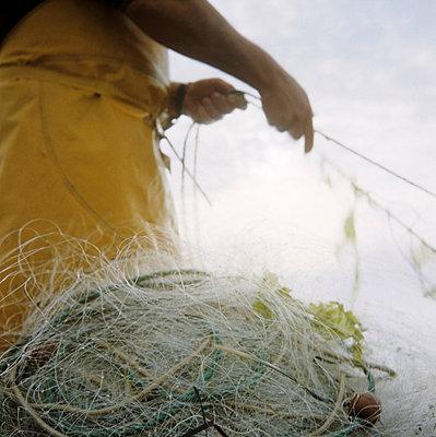 Fisherman at work - p7090014 by Axel Kohlhase