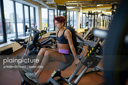 Young woman doing fitness training - p1646m2278493 by Slava Chistyakov
