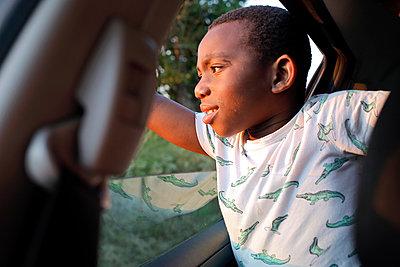 Boy in a car - p1307m2122274 by Agnès Deschamps