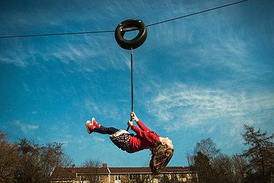 Little girl at playground uses rope bridge - p1418m2002156 by Jan Håkan Dahlström