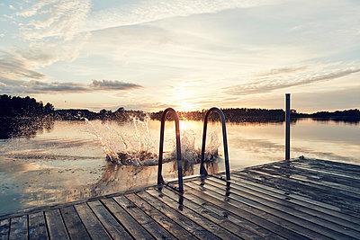 Water splashing on lake - p312m1522295 by Johan Alp