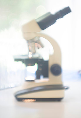 Microscope in laboratory - p1427m2213529 by Tetra Images