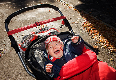 Crying baby in pram - p312m889282f by Johner