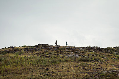 Two hikers on a hill - p1477m1586432 by rainandsalt