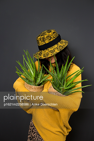 Woman with plants - p1621m2258586 by Anke Doerschlen