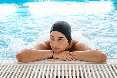 Young woman enjoying thermal bath in a spa center - p1166m2189711 by Cavan Images