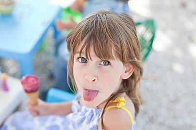 Girl sticking tongue out - p699m1525705 by Sonja Speck