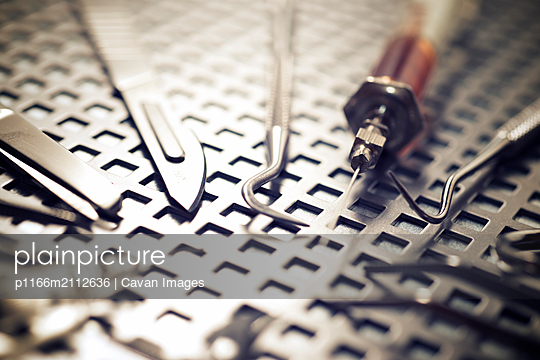 High angle close-up of medical supplies on metallic table - p1166m2112636 by Cavan Images