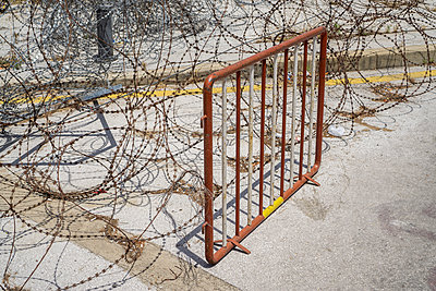 Road blocked with razor wire and metal fence  - p794m2108394 by Mohamad Itani