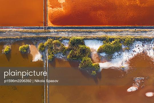 Aerial view of colorful salt lake - p1596m2206392 by Nikola Spasov