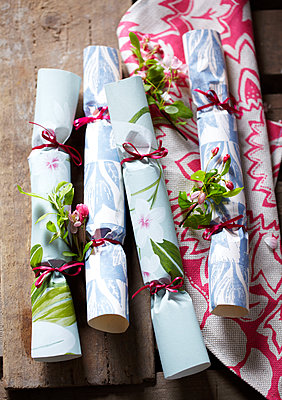 Homemade crackers from floral wallpaper tied with pink ribbon - p349m2167884 by Sussie Bell