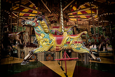Merry-go-round fun fair horse painted colorful old - p609m1192662 by OSKARQ