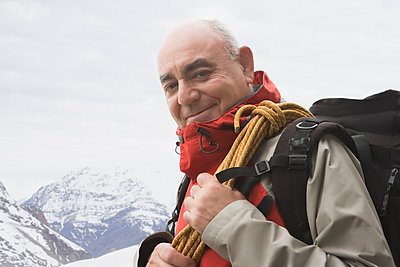 Portrait of senior male mountain climber - p924m1022717f by REB Images