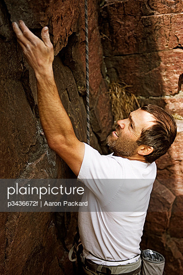 A man sport climbs at Palisades State Park, South Dakota