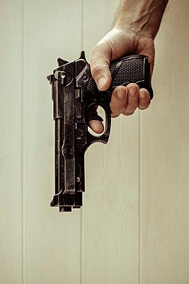 Man with gun close up - p1228m1072165 by Benjamin Harte