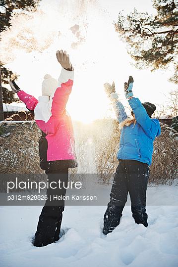 Girls playing at winter, Saltsjobaden, Nacka, Sweden