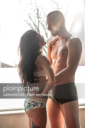 Semi-naked hipster couple bonding at home - p429m2091223 by Frank and Helena