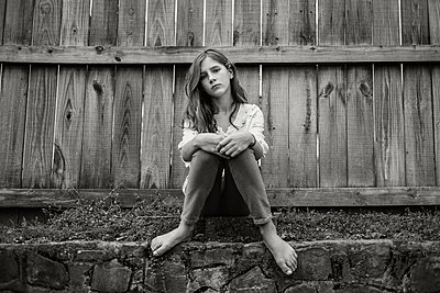 Girl Sitting Along Fence - p1503m2020419 by Deb Schwedhelm