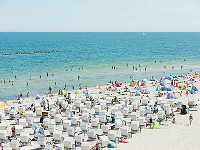 People in beach booth at Island of Rugen - p300m660134f by Leon Fischer